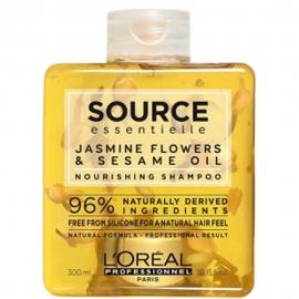 Bouteille de shampoing nourrissant source de la marque L'Oréal Pro à base de fleurs de jasmin et d'huile de sésame